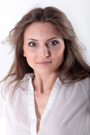 beautiful girl in a white blouse angry and disheveled