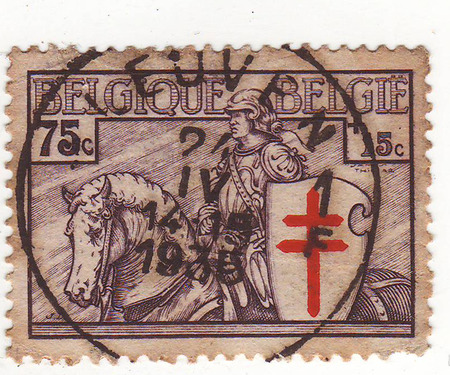 maturity: postage stamp, Belgium, shows a man in armor riding on horses, price 75, year of maturity in 1935 Stock Photo