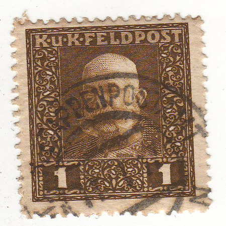 depicts: the stamp depicts a man in military uniform, black and white, the price of 1,