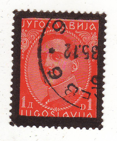 the image of the man in the uniform of the Yugoslav red stamp with a black border, the price of 1 Dinar, quenched in 1935