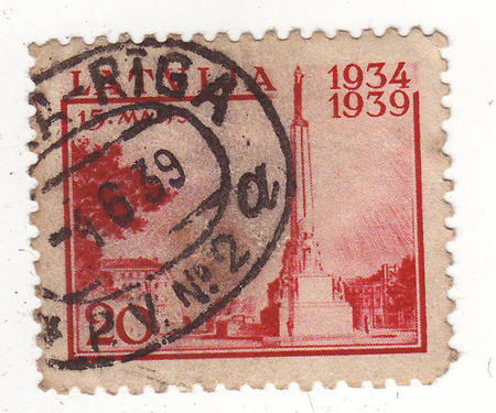 suppressed: the image of the monument on the red brand, price 40, suppressed in 1939 in Riga Stock Photo