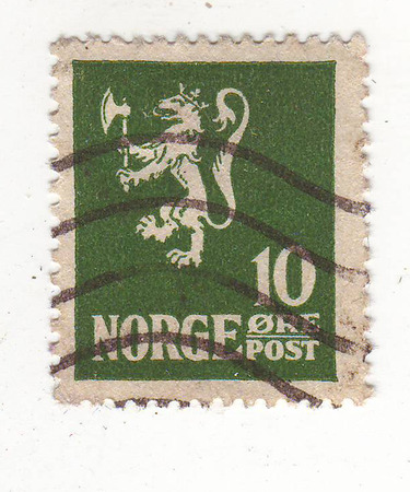 rampant: the image of a rampant lion, crowned and holding the axe in front paws on the green stamp, the price of 10