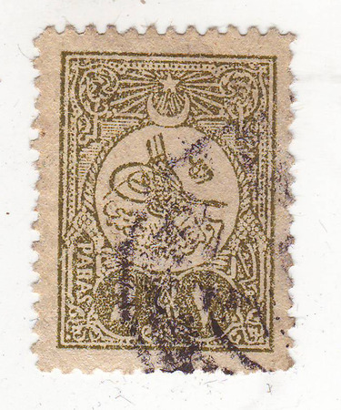 forwarding: image of Arabic character on grey green brand, price 2 Stock Photo