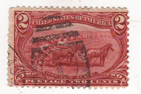 philately: the image of the four horses harnessed in agricultural tool on the red brand, price 2 cents Stock Photo