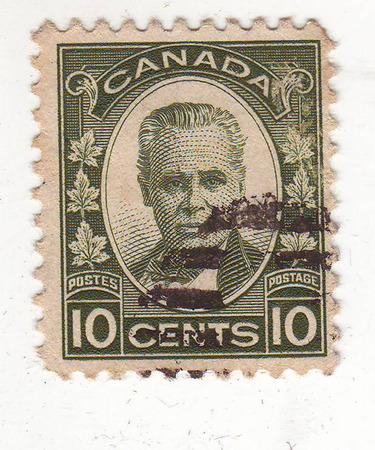 beeld van portret van een man in burger op een groen merk, prijs 10 cent