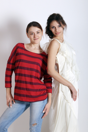 evening gowns: model showing the development of the student designer evening gowns with the author Stock Photo