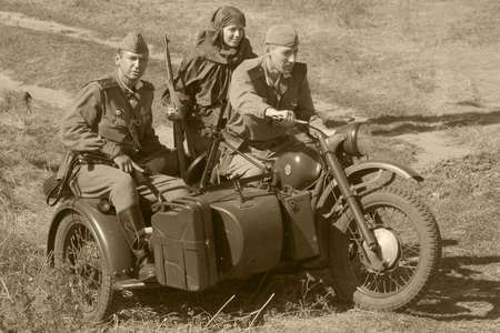 memoirs: reconstruction of the breakthrough of the Mius front of the farm Baranovka, a group of soldiers on a motorcycle with kalashi