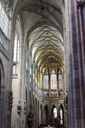 vitus: the interior of St. Vitus Cathedral, columns, stained glass, ceiling Editorial