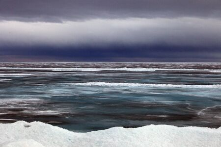hummock: Lake Baikal in April, cloudy weather, low clouds, Stock Photo