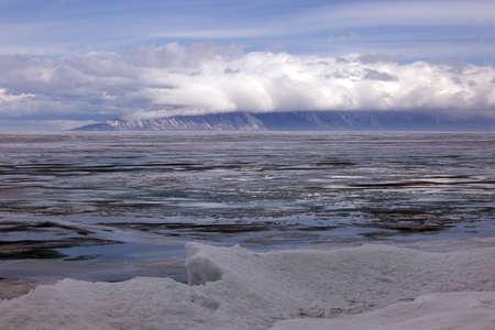 hummock: Baikal in April, rainy cloudy weather