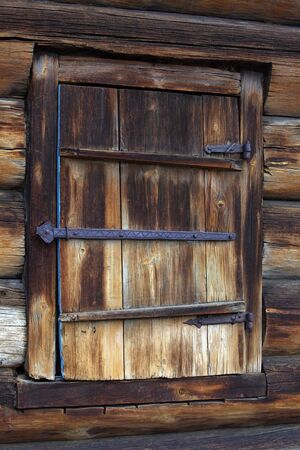mastery: Museum of wooden architecture, wooden shutter with wrought iron hinges
