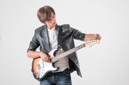 Young man with electric guitar Stock fotó