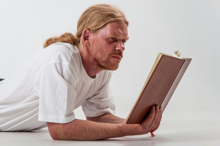 Serious man with book