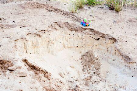 rupture: Toy dump-truck in the sands, near rupture