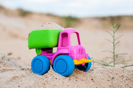 dumptruck: Toy dump-truck in the sands, summer, day