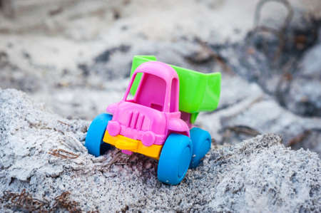 Toy dump-truck in the ashes, summer, day Stock Photo
