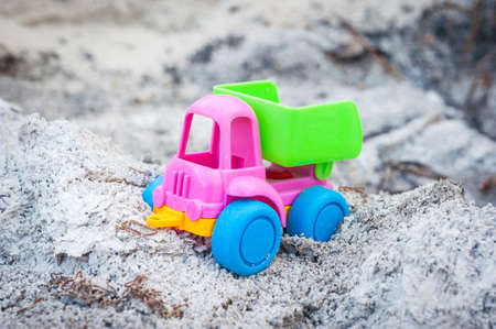 dumptruck: Toy dump-truck in the ashes, summer, day Stock Photo
