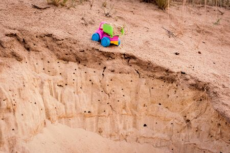 rupture: Toy dump-truck in the sands, summer, day