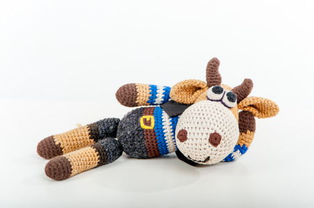 soft toy: Soft toy lying bull on white background
