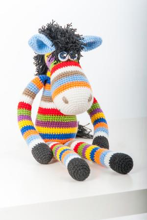 soft toy: Soft toy bright zebra on white background