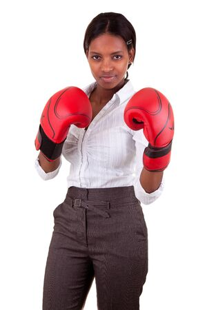 woman boxing gloves: Young African American woman wearing boxing gloves Stock Photo