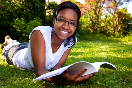 Young Student reading books at the school park Stock Photo - 9010854