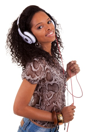 black teens: Young beautiful black woman listening to music Stock Photo