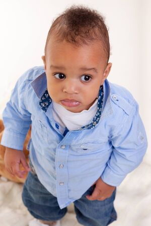 mixed ethnicities: Portrait of a cute black baby isolated on white background