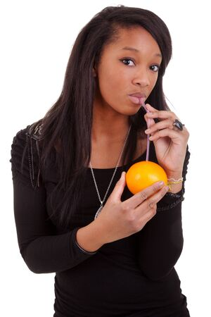 young black woman drinking orange juice Stock Photo - 9418570