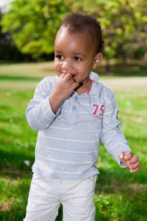 Portrait of a african american  baby boy playing  in the park Stock Photo - 9436956