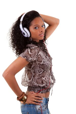 Young beautiful black woman listening to music Stock Photo - 9482315