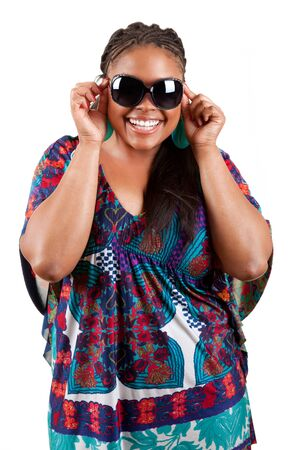 beautiful african american woman wearing sunglasses over a white background photo