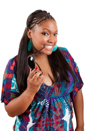 plus sized: beautiful african american woman holding sunglasses over a white background