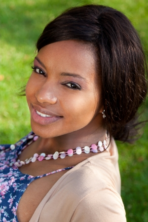 mixed ethnicities: Closeup outdoor portrait of a beautiful black woman