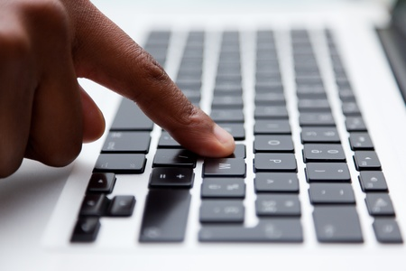 Female finger typing on computer keyboard photo