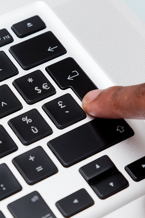 pressing: Female finger typing on computer keyboard