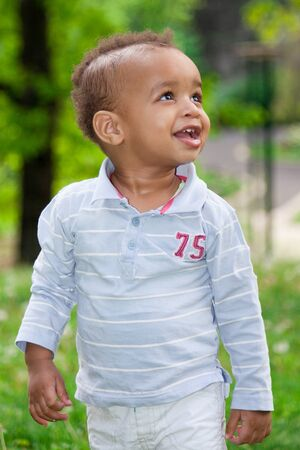 Portrait of a african american  baby boy playing  at the park photo