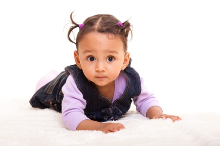 Beautiful mixed race baby lying on the floor photo