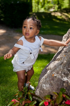 mixed races: Cute african american baby boy at park Stock Photo