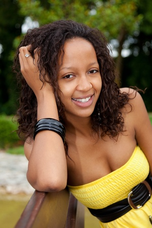 brazilian ethnicity: Portrait of a young beautiful african american woman sitting on a bench Stock Photo