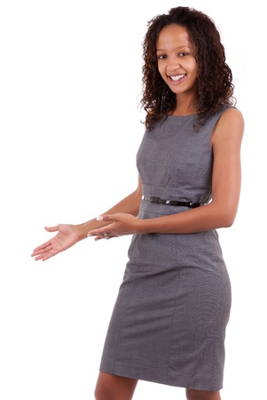brazilian ethnicity: Smiling african american  business woman making a welcoming gesture
