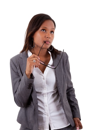 african american businesswoman: Thoughtful african american businness woman holding glasses , isolated on white background Stock Photo