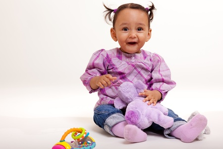 Beautiful mixed race baby surprised photo