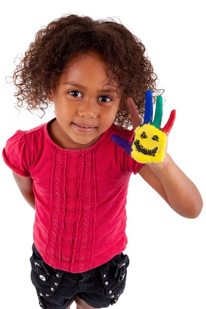 mixed ethnicities: Little African Asian girl with painted hands in colorful paints Stock Photo