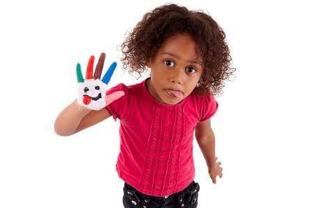 african art: Little African Asian girl with painted hands in colorful paints Stock Photo