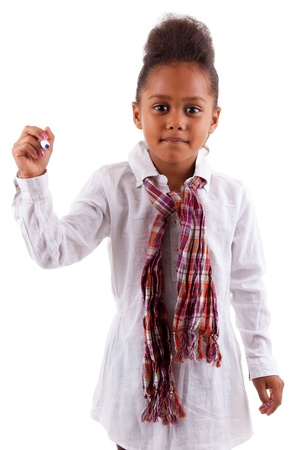Adorable little African Asian girl holding a pen, isolated on white background photo
