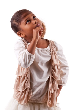 Thoughtful little African Asian girl,  over white background photo