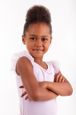 little girl dancing: Cute little African Asian girl smiling ,with folded arms Stock Photo
