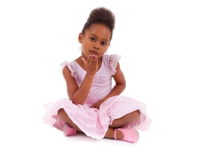 sitting on floor: Cute little African Asian girl sitting on the floor,  isolated on white background