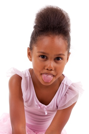 Cute little African Asian girl sticking tongue out, isolated on white background photo